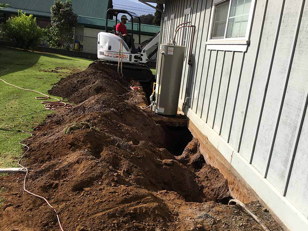 Digging is the first step in repairing a home foundation