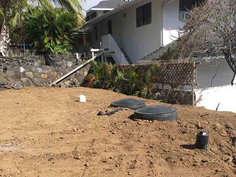 Putting the top layer of soil over the entire septic system