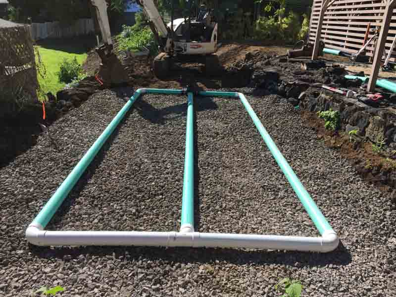 Setting up the drainage field for the septic tank